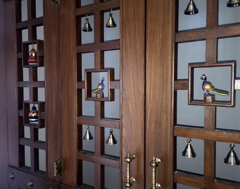 pooja room door designs with bells