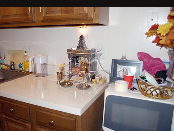 pooja mandir in kitchen