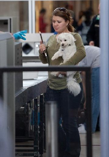 Kelly cuddles her dog
