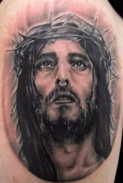 JesusFace Tattoo On Arm