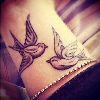dove tattoos on wrist