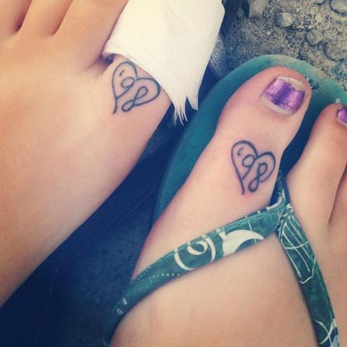 25 Stylish & Cute Matching Tattoos for Couples - Matching Friendship year tattoo