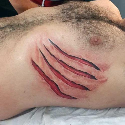 Impressive Ripped Skin Tattoo Design