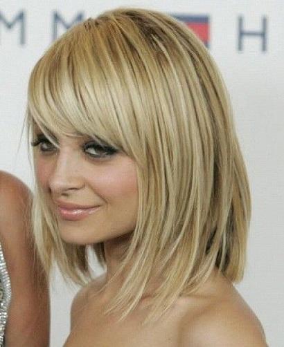 Medium Razor Cut Hairstyle with Fringe