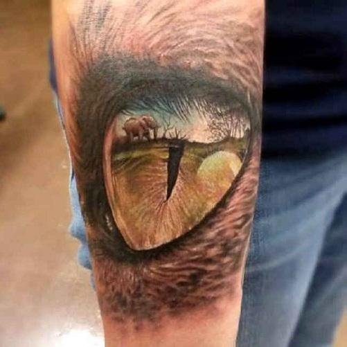 Glaring Reptile Tattoo Design