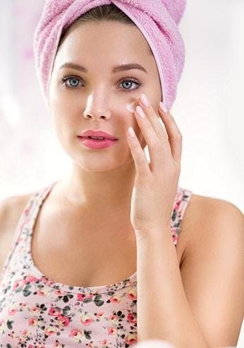Applying cream on eyes