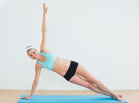 Fat Burning Exercises - Side Plank with Leg Raises