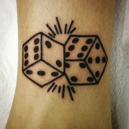 Small dice tattoo